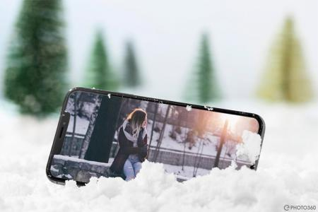 Collage photo on smartphone frame on snow background
